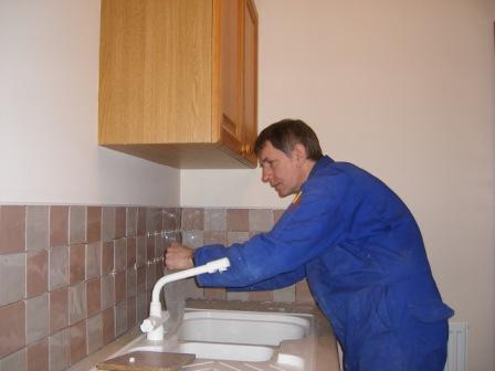 T.P. Kitchen and Bathroom Tiling Services working on kitchen in Walsall West Midlands